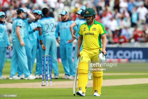 Aaron Finch of Australia leaves the field after being given out LBW to Jofra Arched of England during the SemiFinal match of the ICC Cricket World...