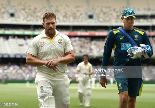 Aaron Finch of Australia leaves the ground after being struck on the hand by a delivery from Ishant Sharma of India during day three of the second...