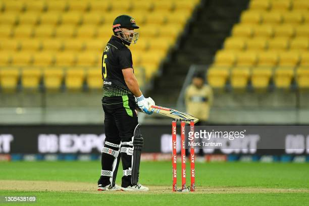 Aaron Finch of Australia looks back to acknowledge his 50 runs during game four of the International T20 series between New Zealand Blackcaps and...