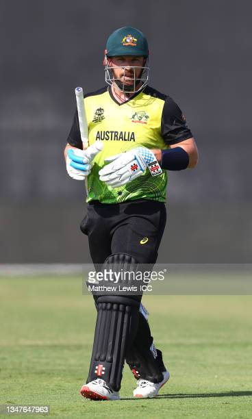 Aaron Finch of Australia makes their way off after being dismissed during the India and Australia warm Up Match prior to the ICC Men's T20 World Cup...