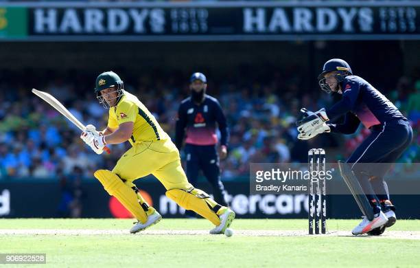Aaron Finch of Australia plays a shot during game two of the One Day International series between Australia and England at The Gabba on January 19...