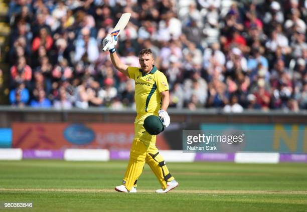 Aaron Finch of Australia raises his bat after scoring 100 runs during the 4th Royal London ODI match between England and Australia at Emirates Durham...