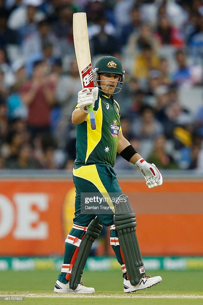 Aaron Finch of Australia raises his bat after scoring 50 runs during the One Day International match between Australia and India at Melbourne Cricket Ground on January 18, 2015 in Melbourne, Australia.