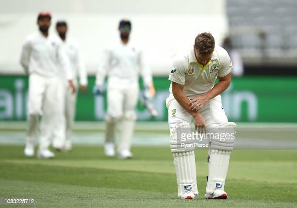 Aaron Finch of Australia reacts after he was struck on the hand by a delivery from Ishant Sharma of India during day three of the second match in the...