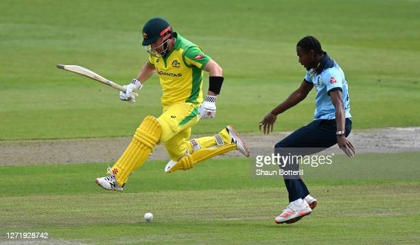 Aaron Finch of Australia runs as Jofra Archer of England attempts to field during the 1st Royal London One Day International Series match between...