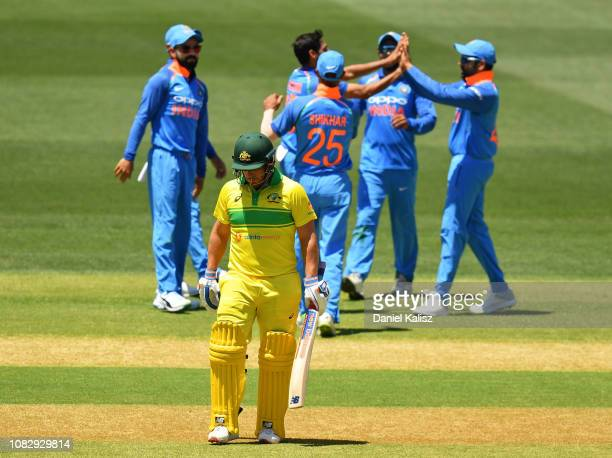 Aaron Finch of Australia walks from the field after being dismissed during game two of the One Day International series between Australia and India...