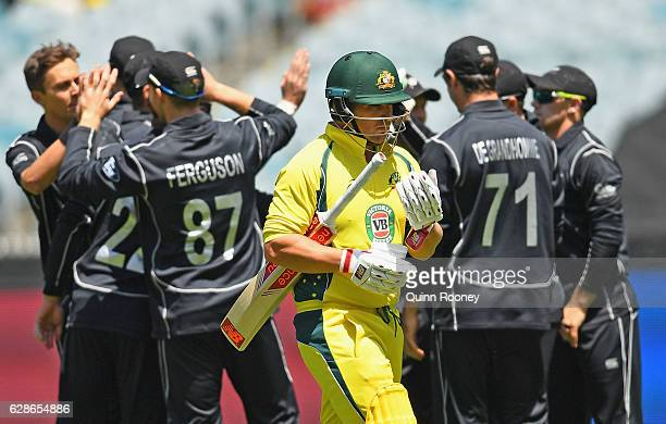 Aaron Finch of Australia walks from the field after being dismissed off the bowling of Trent Boult of New Zealand during game three of the One Day...