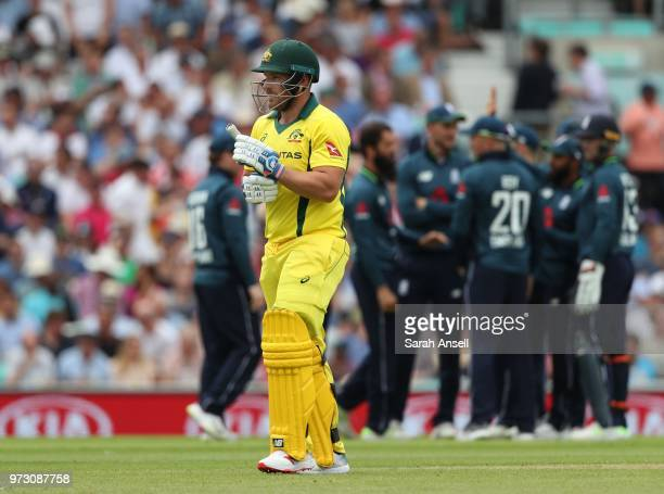 Aaron Finch of Australia walks off after being dismissed by England's Moeen Ali during the 1st Royal London ODI between England and Australia at The...