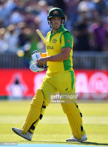 Aaron Finch of Australia walks off after being dismissed off the bowling of Imran Tahir of South Africa during the Group Stage match of the ICC...