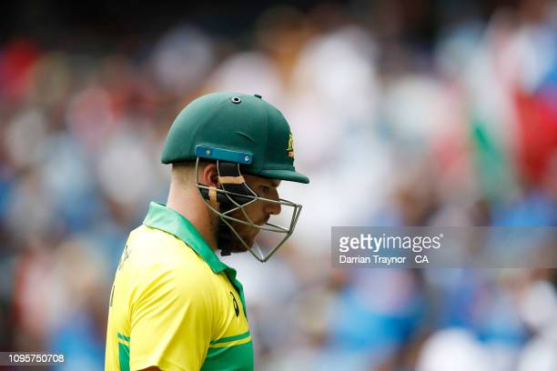 Aaron Finch of Australia walks off the field after being dismissed during game three of the One Day International series between Australia and India...