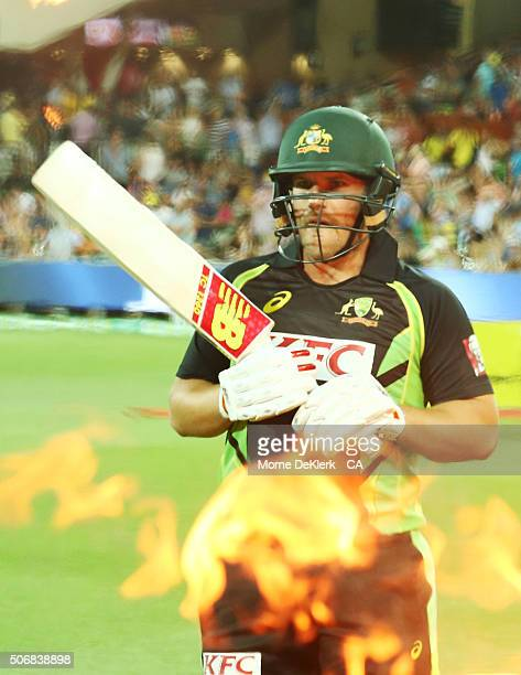Aaron Finch of Australia walks out to bat during game one of the Twenty20 International match between Australia and India at Adelaide Oval on January...