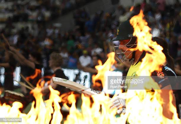 Aaron Finch of Australia walks out to bat during game one of the the International Twenty20 series between Australia and India at The Gabba on...