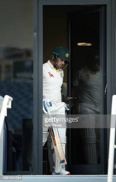 Aaron Finch of Australia walks out to open the batting during day two of the First Test match in the series between Australia and Pakistan at Dubai...