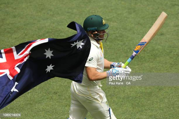 Aaron Finch of Australia walks out to open the batting in the second innings during day three of the second match in the Test series between...