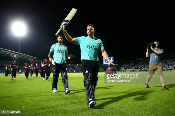 Aaron Finch of Surrey acknowledges the crowd as he leaves the field after finishing 102 not out during the Vitality T20 Blast match between Surrey...