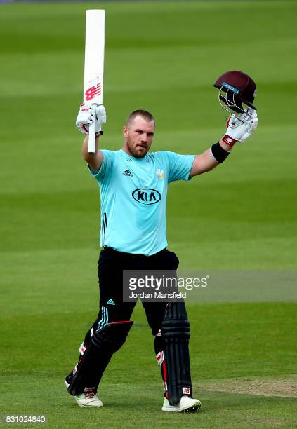 Aaron Finch of Surrey celebrates his century during the NatWest T20 Blast match between Surrey and Sussex Shark at The Kia Oval on August 13 2017 in...