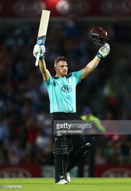 Aaron Finch of Surrey celebrates his century during the Vitality T20 Blast match between Surrey and Somerset at The Kia Oval on August 27 2019 in...