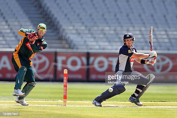 Aaron Finch of the Bushrangers bats and hits a boundary during the Ryobi One Day Cup match between Victorian Bushrangers and the Tasmanian Tigers at...