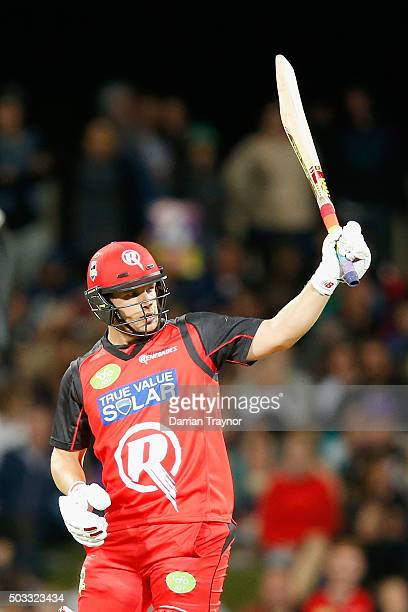 Aaron Finch of the Melbourne Renegades raises his bat after scoring 50 runs during the Big Bash League match between the Hobart Hurricanes and the...