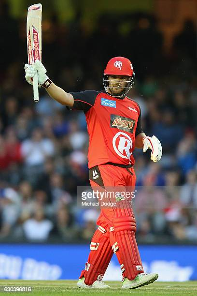 Aaron Finch of the Renegades celebrates 50 runs during the Big Bash League match between the Melbourne Renegades and Sydney Thunder at Etihad Stadium...
