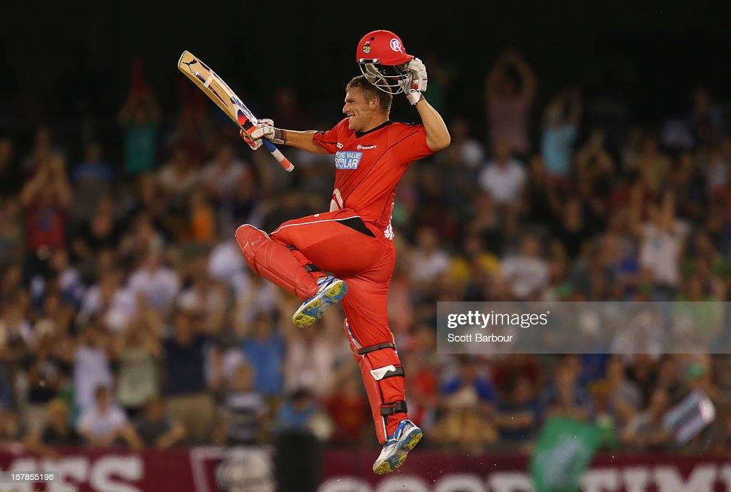 Aaron Finch of the Renegades celebrates as he reaches his century during the Big Bash League match between the Melbourne Renegades and the Melbourne Stars at Etihad Stadium on December 7, 2012 in Melbourne, Australia.