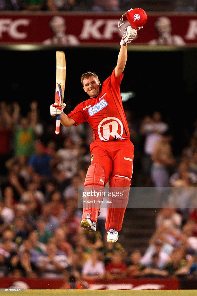 Aaron Finch of the Renegades celebrates his century during the Big Bash League match between the Melbourne Renegades and the Melbourne Stars at Etihad Stadium on December 7, 2012 in Melbourne, Australia.