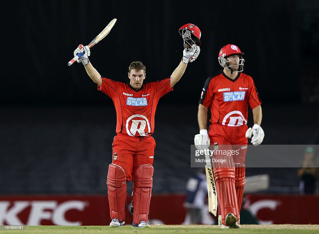Aaron Finch of The Renegades celebrates his century with Cameron White during the Big Bash League match between the Melbourne Renegades and the Melbourne Stars at Etihad Stadium on December 7, 2012 in Melbourne, Australia.