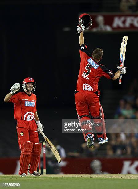Aaron Finch of The Renegades celebrates his century with Cameron White during the Big Bash League match between the Melbourne Renegades and the...