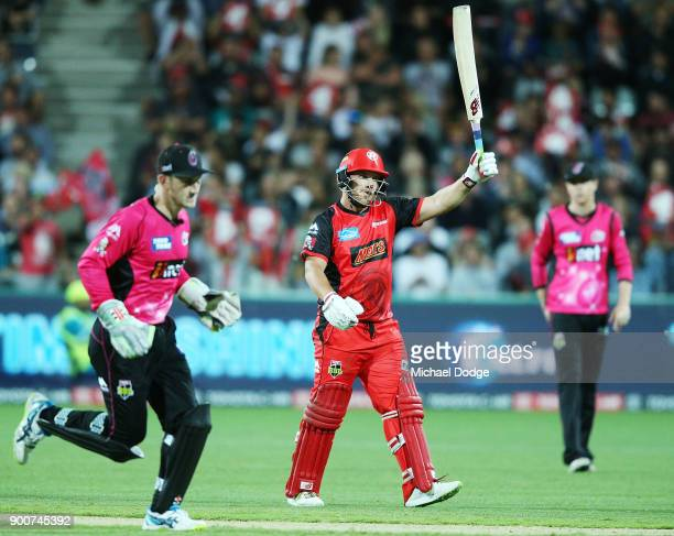 Aaron Finch of the Renegades celebrates making his half century during the Big Bash League match between the Melbourne Renegades and the Sydney...
