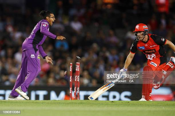 Aaron Finch of the Renegades is run out by Johan Botha of the Hurricanes during the Big Bash League match between the Melbourne Renegades and the...