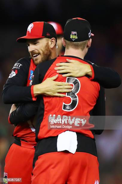 Aaron Finch of the Renegades of the Renegades celebrates a catch by Mackenzie Harvey of the Renegades during the Big Bash League match between the...