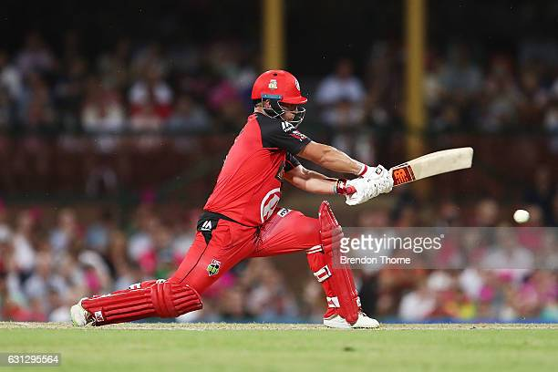 Aaron Finch of the Renegades plays reverse sweep shot during the Big Bash League match between the Sydney Sixers and the Melbourne Renegades at...