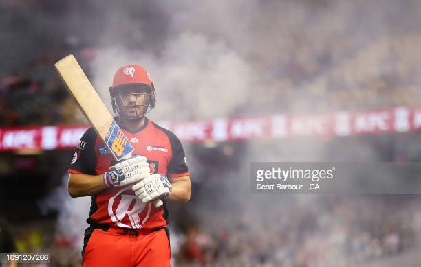 Aaron Finch of the Renegades walks out to bat during the Big Bash League match between the Melbourne Renegades and Sydney Thunder at Marvel Stadium...
