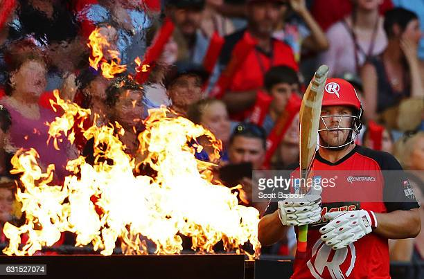 Aaron Finch of the Renegades walks out to bat past flames during the Big Bash League match between the Melbourne Renegades and the Hobart Hurricanes...
