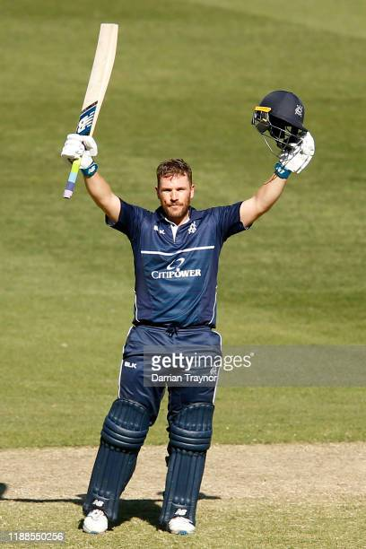 Aaron Finch of Victoria raises his bat after scoring 100 runs during the Marsh One Day Cup match between Victoria and South Australia at Melbourne...