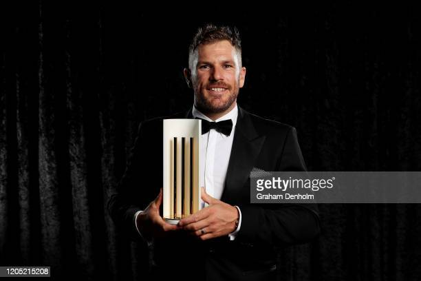 Aaron Finch poses with the Australian Men's ODI Player of the Year award during the 2020 Cricket Australia Awards at Crown Palladium on February 10...