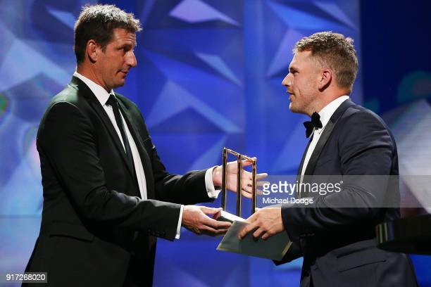 Aaron Finch saccepts his award from Michael Kasprowicz at the 2018 Allan Border Medal at Crown Palladium on February 12 2018 in Melbourne Australia