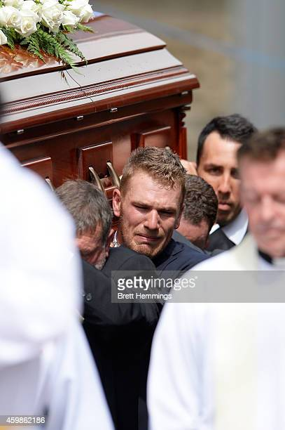 Aaron Finch shows his emotions while carry Phillip Hughes casket during the Funeral Service for Phillip Hughes on December 3 2014 in Macksville...