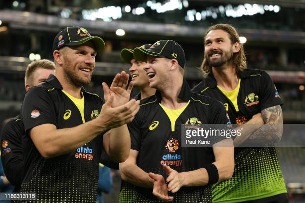 Aaron Finch, Steven Smith and Kane Richardson of Australia look on before presentations during game three of the International Twenty20 series...