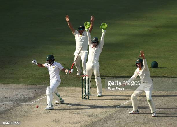 Aaron Finch Tim Paine and Marnus Labuschagne of Australia appeal for the wicket of Azhar Ali of Pakistan during day one of the First Test match in...