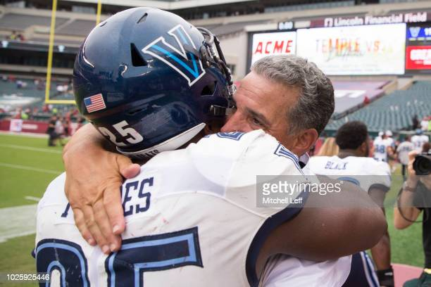 Aaron Forbes of the Villanova Wildcats hugs head coach Mark Ferrante after the game against the Temple Owls at Lincoln Financial Field on September...