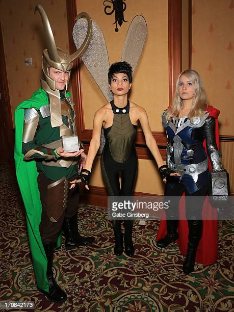 """Aaron Forrester, dressed as the character Loki from the """"Thor"""" comic book franchise, Sara Gonzales, dressed as the character Ultimate Wasp from the..."""