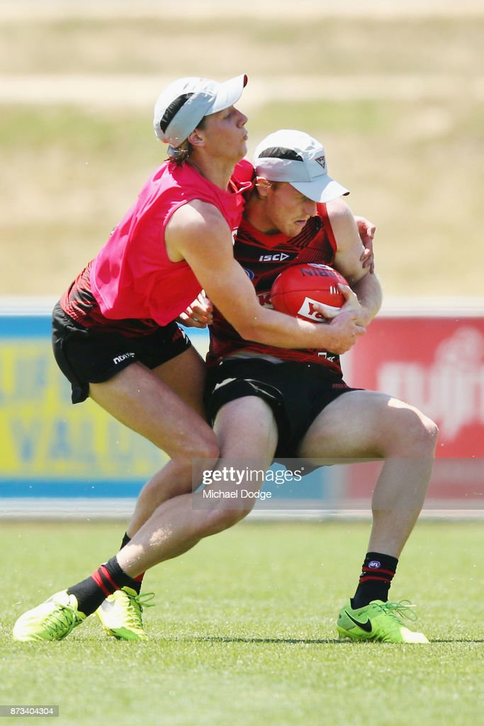 Aaron Francis of Essendon gets tackled by Kobe Mutch of Essendon during an Essendon Bombers AFL training session at the Essendon Football Club on November 13, 2017 in Melbourne, Australia.