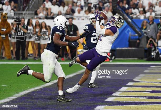 Aaron Fuller of the Washington Huskies catches a 28 yard touchdown pass behind Jason Cabinda of the Penn State Nittany Lions during the second half...