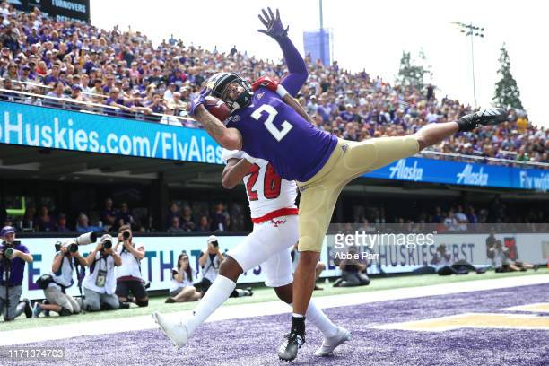 Aaron Fuller of the Washington Huskies completes a seven yard touchdown pass against Darreon Moore of the Eastern Washington Eagles in the first...