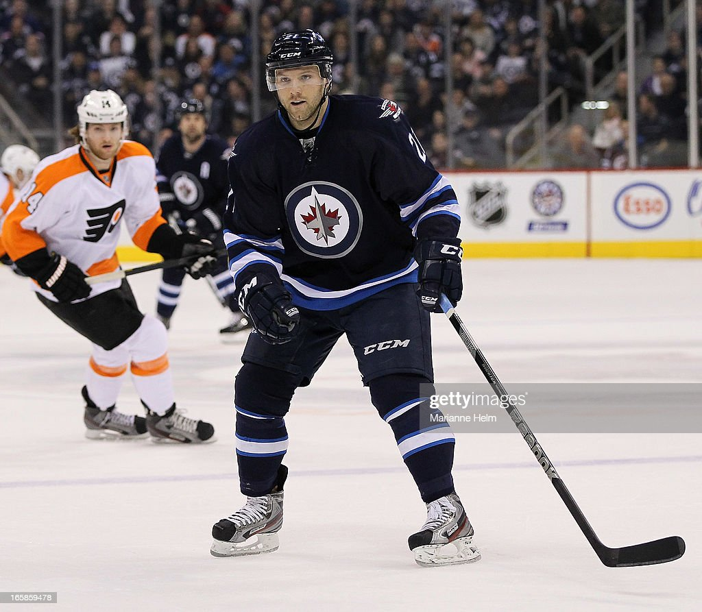 Aaron Gagnon #21 of the Winnipeg Jets skates on the ice during second period in a game between the Winnipeg Jets and the Philadelphia Flyers on April 6, 2013 at the MTS Centre in Winnipeg, Manitoba, Canada.