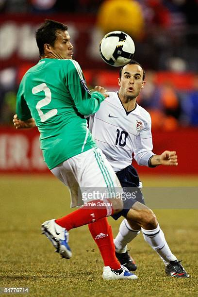 Aaron Galindo of Mexico battles for the ball against Landon Donovan of USA during a FIFA 2010 World Cup qualifying match in the CONCACAF region on...