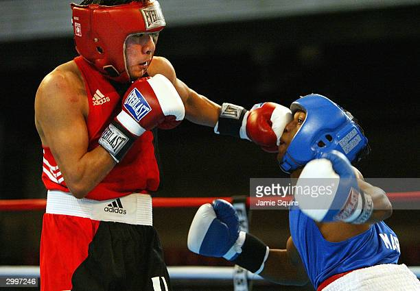 Aaron Garcia lands a punch to the face of Johnnie Edwards during their bout in the United States Olympic Team Boxing Trials on February 19 2004 at...
