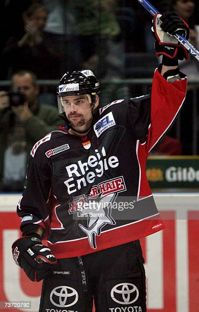 Aaron Gavey of Cologne celebrates scoring the fifth goal during the DEL Bundesliga play off quarter final game between Cologne Haie and ERC...