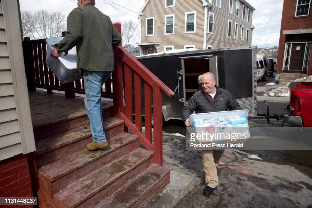 Aaron Geyer who works at Portland's family shelter helps to move in a large donation of goods given to the shelter by congregation members of The...